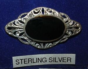 SALE PRICE Brooch set with Oval Onyx , Silver stamped 925