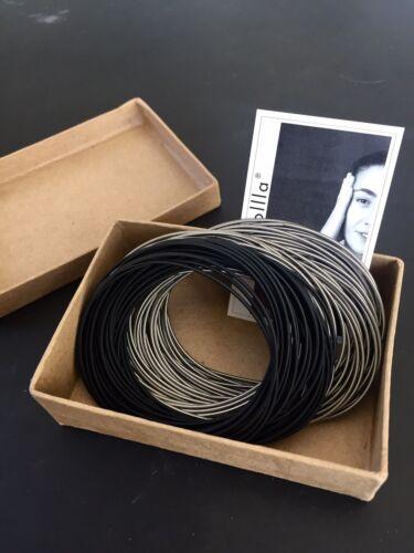 piano wire  jewelry// Spring Wire Bracelet la Mollla Tiziana Redavid la Molla
