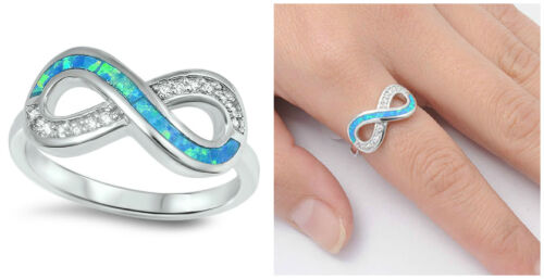 .925 STERLING SILVER 9MM INFINITY LOVE KNOT DESIGN BLUE LAB OPAL CLEAR CZ RING