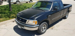 1997 Ford F-150, Crew Cab. A real work horse. Runs great, shifts