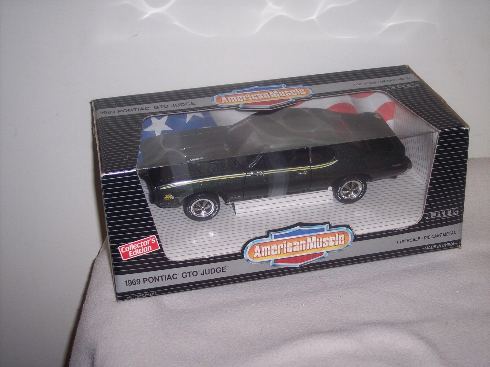 AMERICAN MUSCLE - ERTL-1969 PONTIAC GTO JUDGE- AWESOME- STILL STRAPPED DOWN- NEW