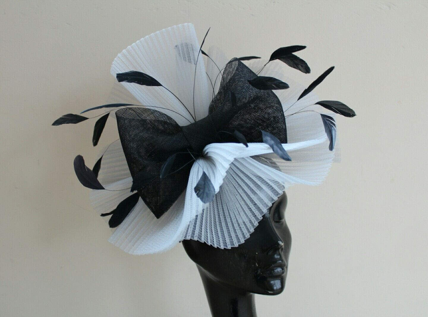 Black and silver fascinator with bow hat hatinator ascot races wedding crin