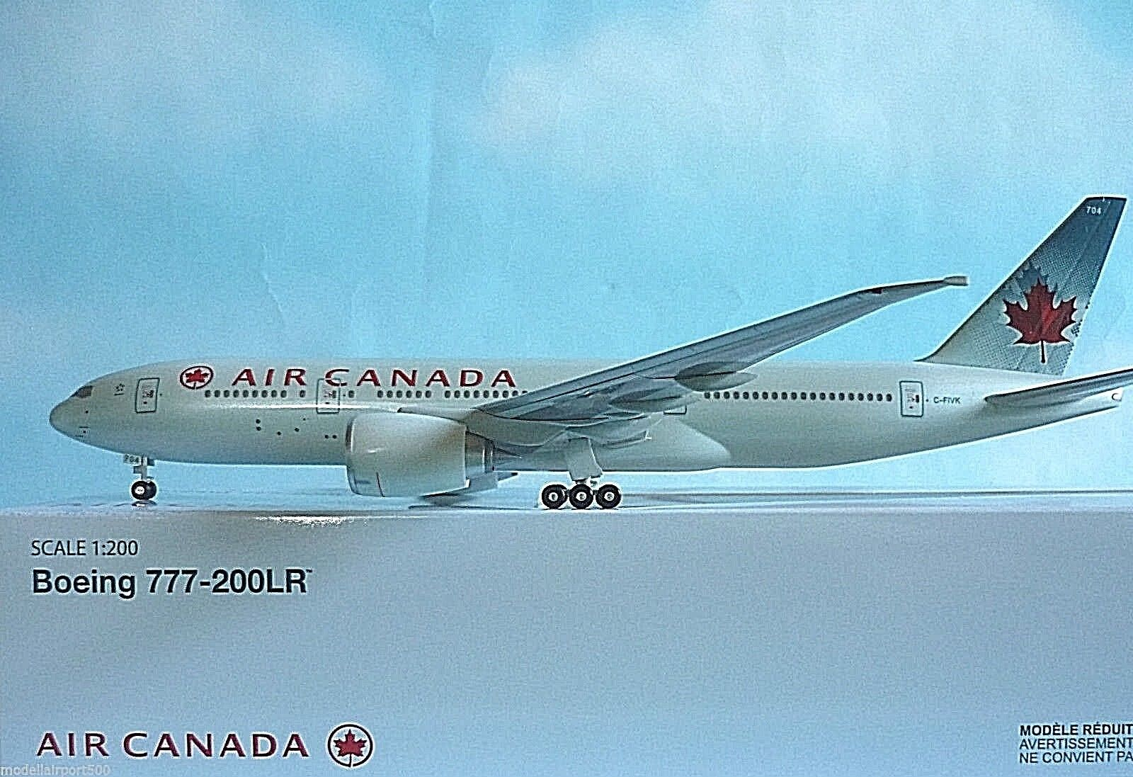HOGAN Wings 1:200 Boeing 777-200lr Air Canada C-fivk li0335 + Herpa WINGS Catalogo