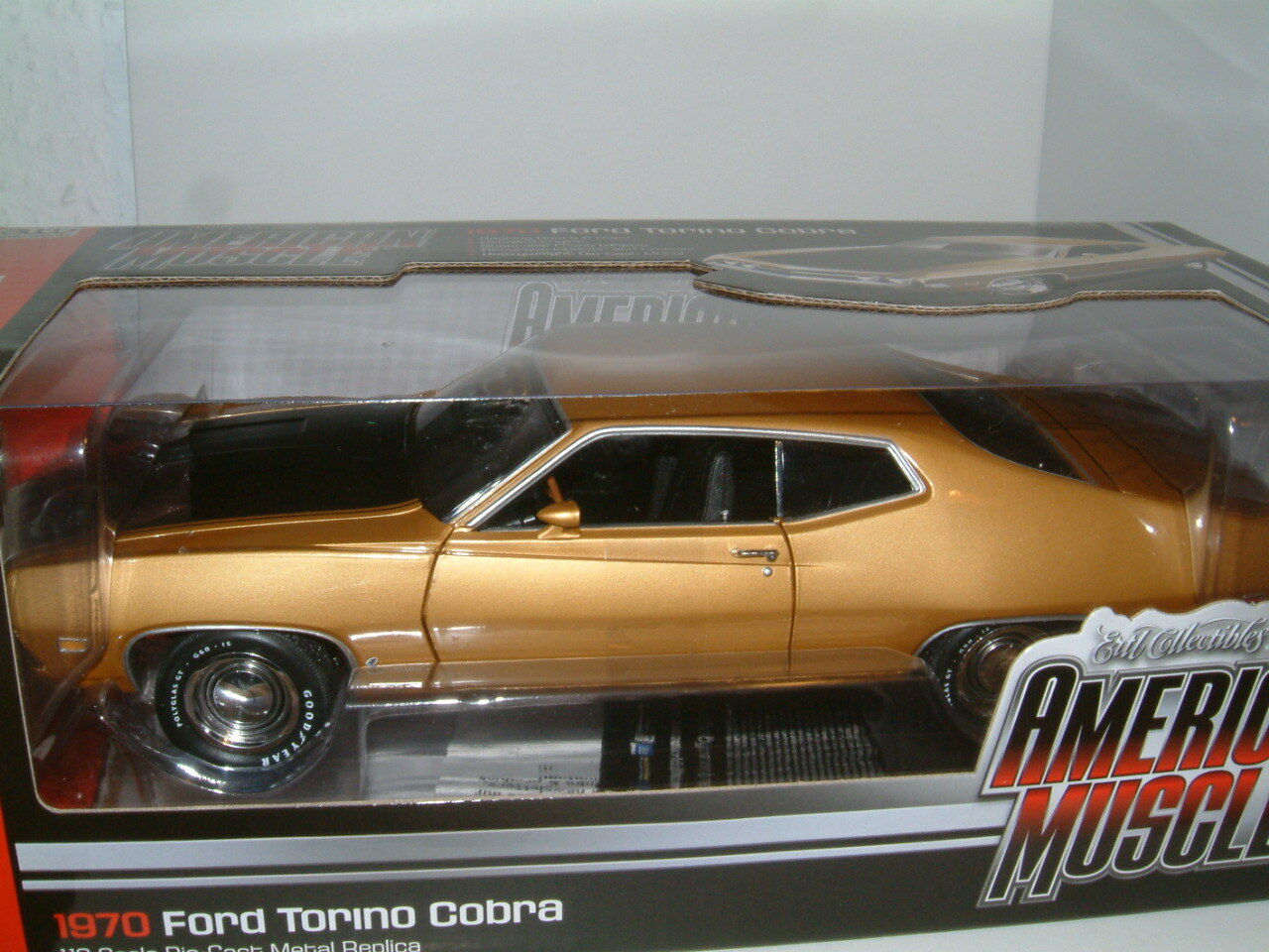 1 18 1970 FORD TORINO COBRA IN METALLIC gold, AUTOWORLD