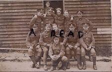 WW1 soldier group 23rd London Regiment outside wooden barrack hut