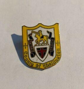 Vintage-Enamel-Pinback-Lapel-Pin-Hat-County-Of-Wellington-Ontario
