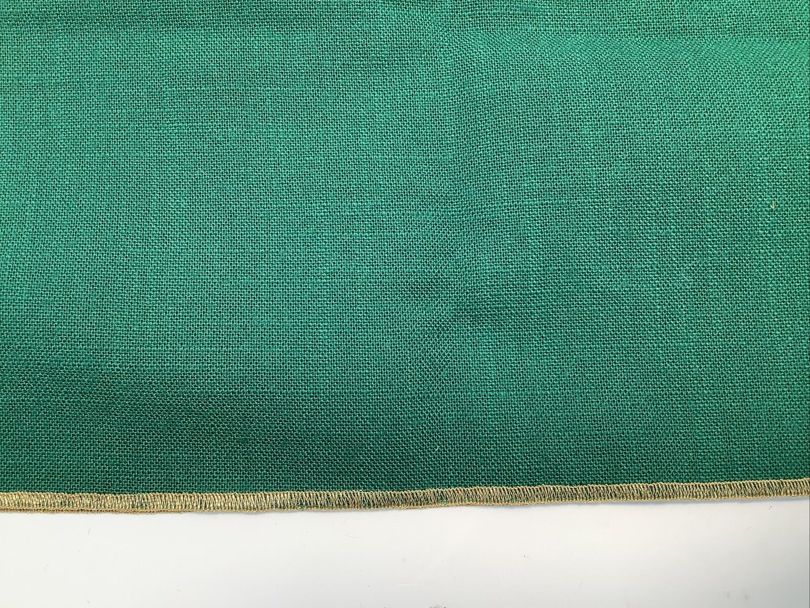 Green Napkin With Gold Stitched Borders