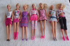 Lote De Muñecas Barbie bastante vestida (3)
