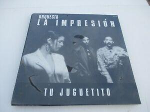 VINTAGE-STILL-SEALED-ORQUESTA-LA-IMPRESION-TU-JUGUETITO-IMPACTO-2000