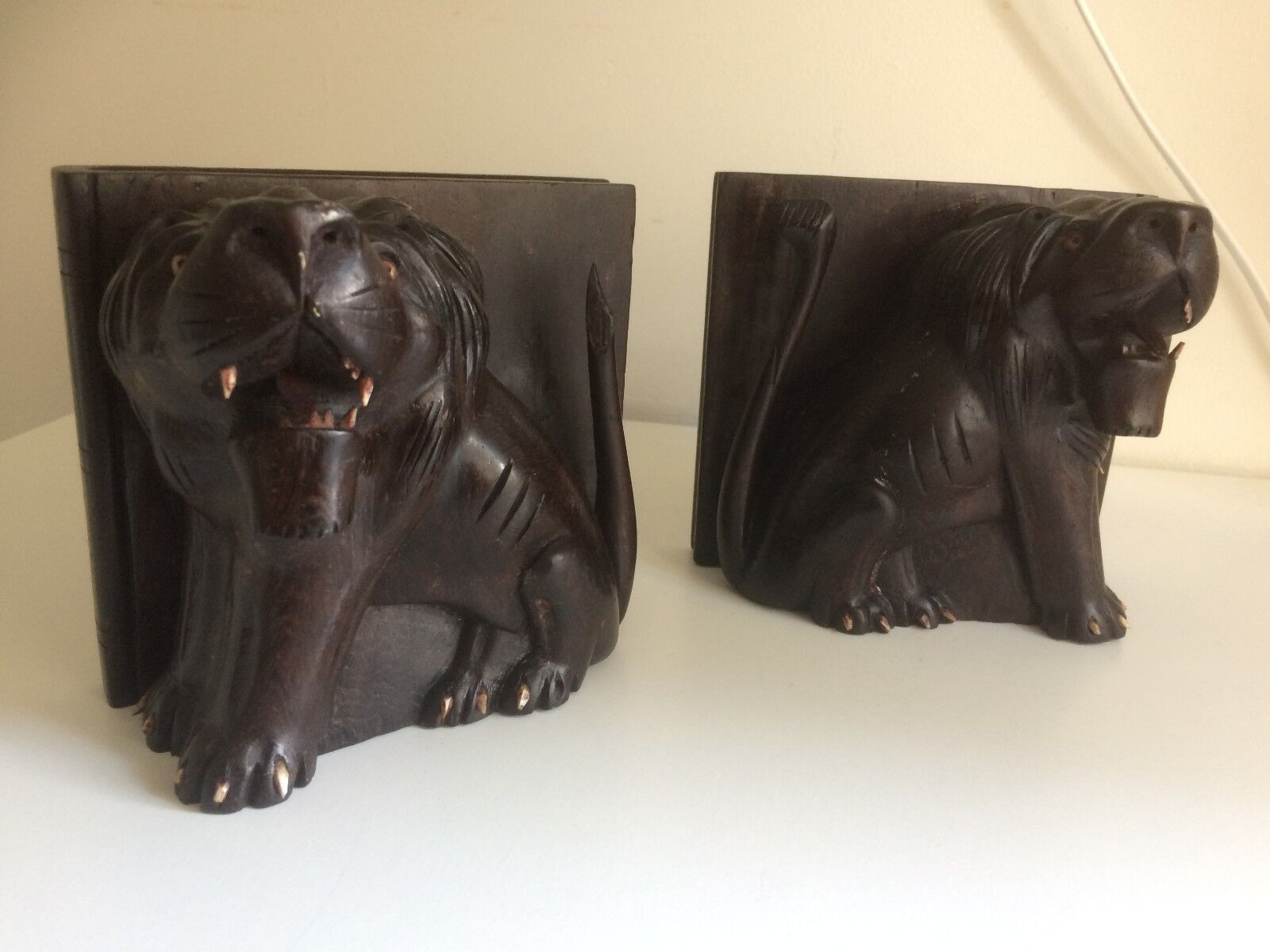 Pair of Vintage Hardwood Bookends in the Form of Lions