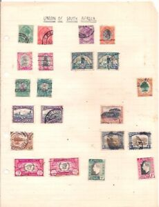 21 old SOUTH AFRICA stamps on an album page.