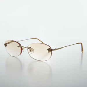 b217976518a3 Image is loading Brown-Tinted-Lens-Reading-Glasses-Oval-Rimless-Frame-