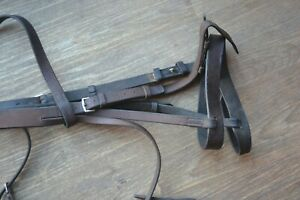 BRIDLE USED TO CLEAR BROWN LEATHER WITH  53 INCH LONG REINS FULL SIZE TO CLEAR