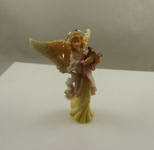 Angel-holding-a-harp-plastic-or-resin-vintage-Christmas-ornament-xmas