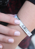 Alpha Phi Omega Bangle With Raised Letters And White Enamel Apo