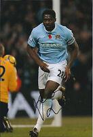 Kolo TOURE SIGNED COA Autograph 12x8 Photo AFTAL In Person Manchester City