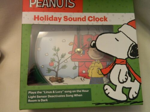 "BATTERY OPERATED NIB PEANUTS HOLIDAY SOUND CLOCK PLAYS /""LINUS /& LUCY/"" SONG"