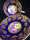 Stunning paragon tea cup saucer Royal Blue Woth Gold Intricate Guilding And Mums
