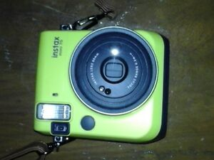 Instax-Mini-70-Yellow-slightly-used-lady-owner