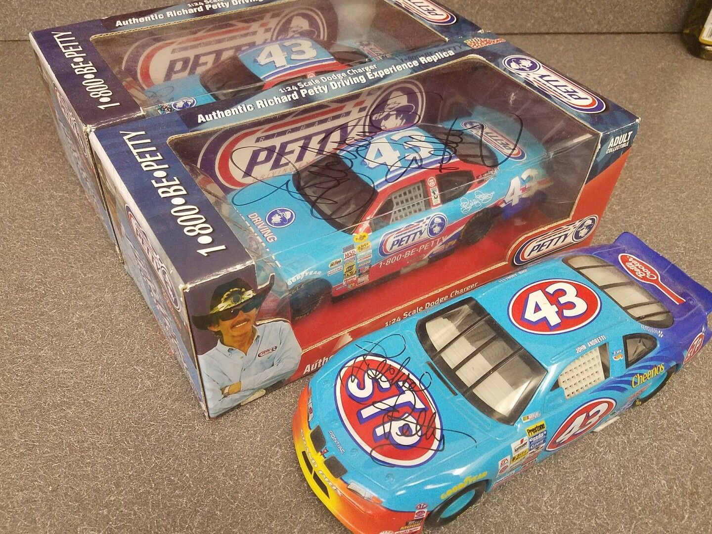 3 Richard petty autographed diecasts