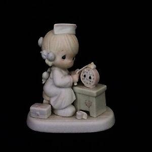 precious moments enesco 523739 figurine time heals retired nurse w