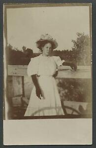 c-1910-RPPC-Photo-Postcard-PRETTY-GIRL-On-Bridge-Flower-Hat-Gloves-Message