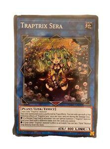 Yu-Gi-Oh-Secret-Rare-Traptrix-Sera-1st-Edition-BLHR-EN049-NM