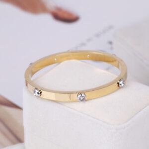 Henri Bendel Gold Metal Rivet Logo Crystal Bangle Bracelet Petite