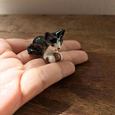 Tuxedo Cat Kitten Laying Down with Ball Black and White Ceramic Cat Figurine