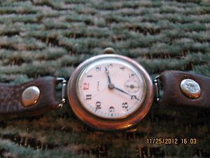 SALE-CYMA-bimetalic-gunmetal-nickel-and-gold-WW1-trench-watch-original-condition