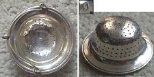 Passe thé passoire en argent massif Minerve