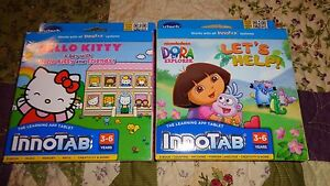 Lot-2-VTECH-INNOTAB-GAME-CARTRIDGES-Dora-Lets-Help-amp-Hello-Kitty-A-day-with-HK