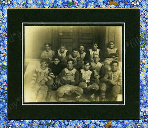 1890s-MUDDY-FOOTBALL-TEAM-JUST-OFF-THE-FIELD-CAST-IRON-NOSE-GUARDS-CABINET-PHOTO