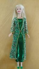 Barbie Doll in emerald green dress with holly cover