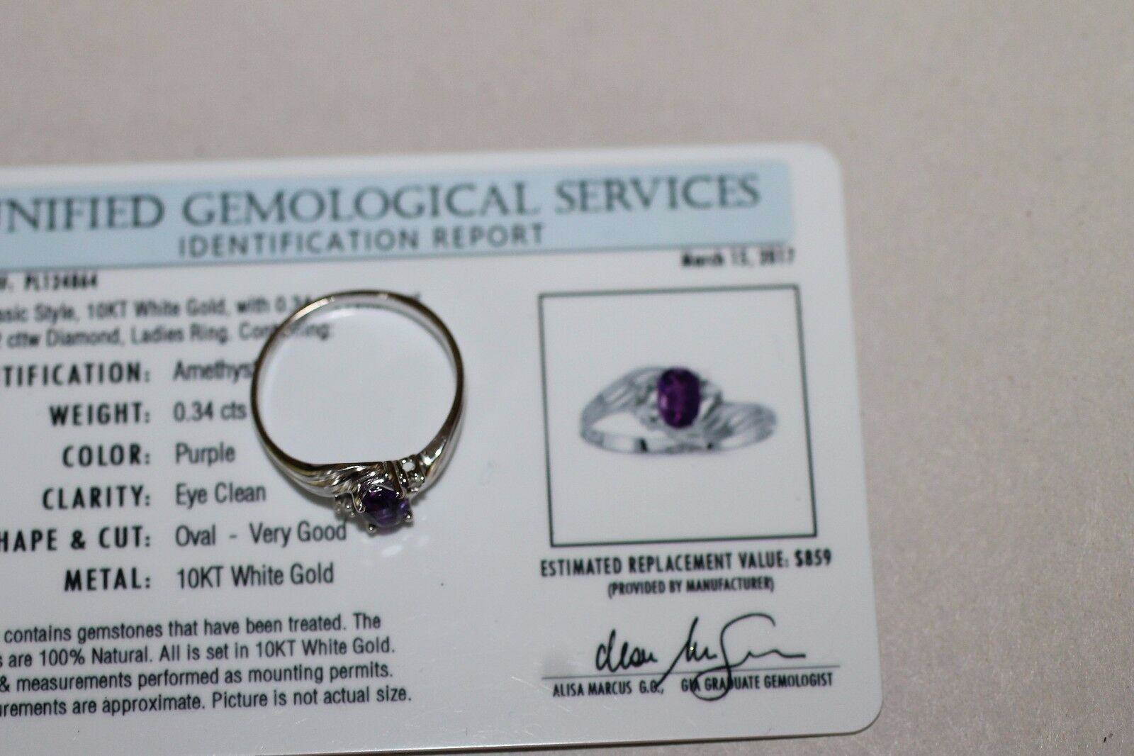 SLASHED PRICE AMETHYST .34 CTS.  RING ON 10 KT. WHITE gold OVAL, VALUE  849