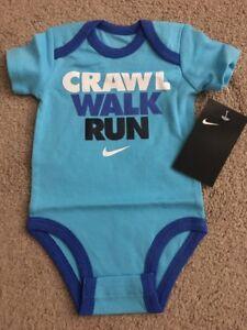 e72ce4cde2d456 NWT Infant Baby Nike Blue Crawl Walk Run Swoosh Logo One Piece ...