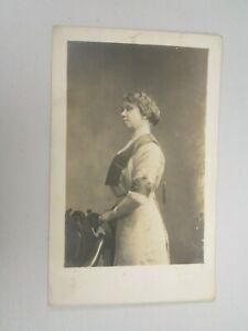 J1121-Postcard-RPPC-woman-with-profile-view