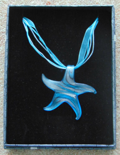 on matching coloured thong and voile ribbon Cobalt blue glass star pendant