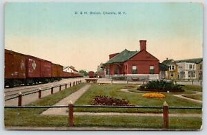 Oenonto-New-York-Freight-Trains-D-amp-H-Railroad-Station-Stores-Behind-Depot-c1910