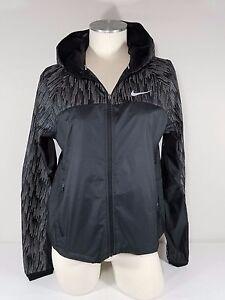 NWT Nike Women s Hooded Flash Reflective Running Jacket 799885 Black ... 8466e900a1076