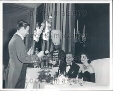 Well Dressed Couple Watches Flaming Shish Kabobs  Press Photo