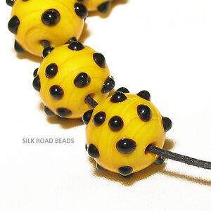 "9 vintage venetian yellow & black raised ""eyes"" glass trade beads #589e"