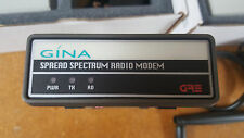 3 GRE Gina 5000N spread spectrum modems with power supplies and antennas.
