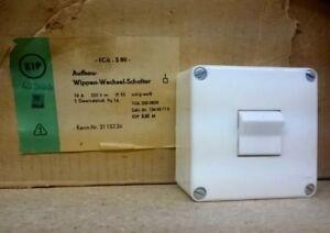 DDR-KP-Aufbau-Wippen-Wechsel-Schalter-250V-10A-IP55-eckig-weiss-21-157-34