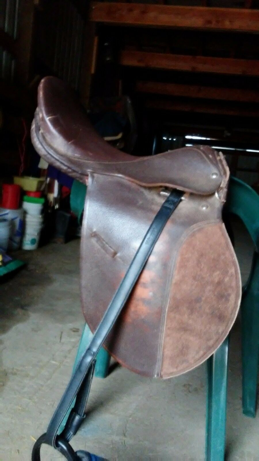 17 english saddle.   Dark brown.  No brand name. Comes with webbers and irons.