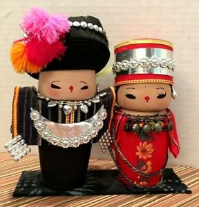 Pair-of-Vintage-Chinese-Wooden-Cartoon-Dolls-in-Ethnic-Minority-Costumes