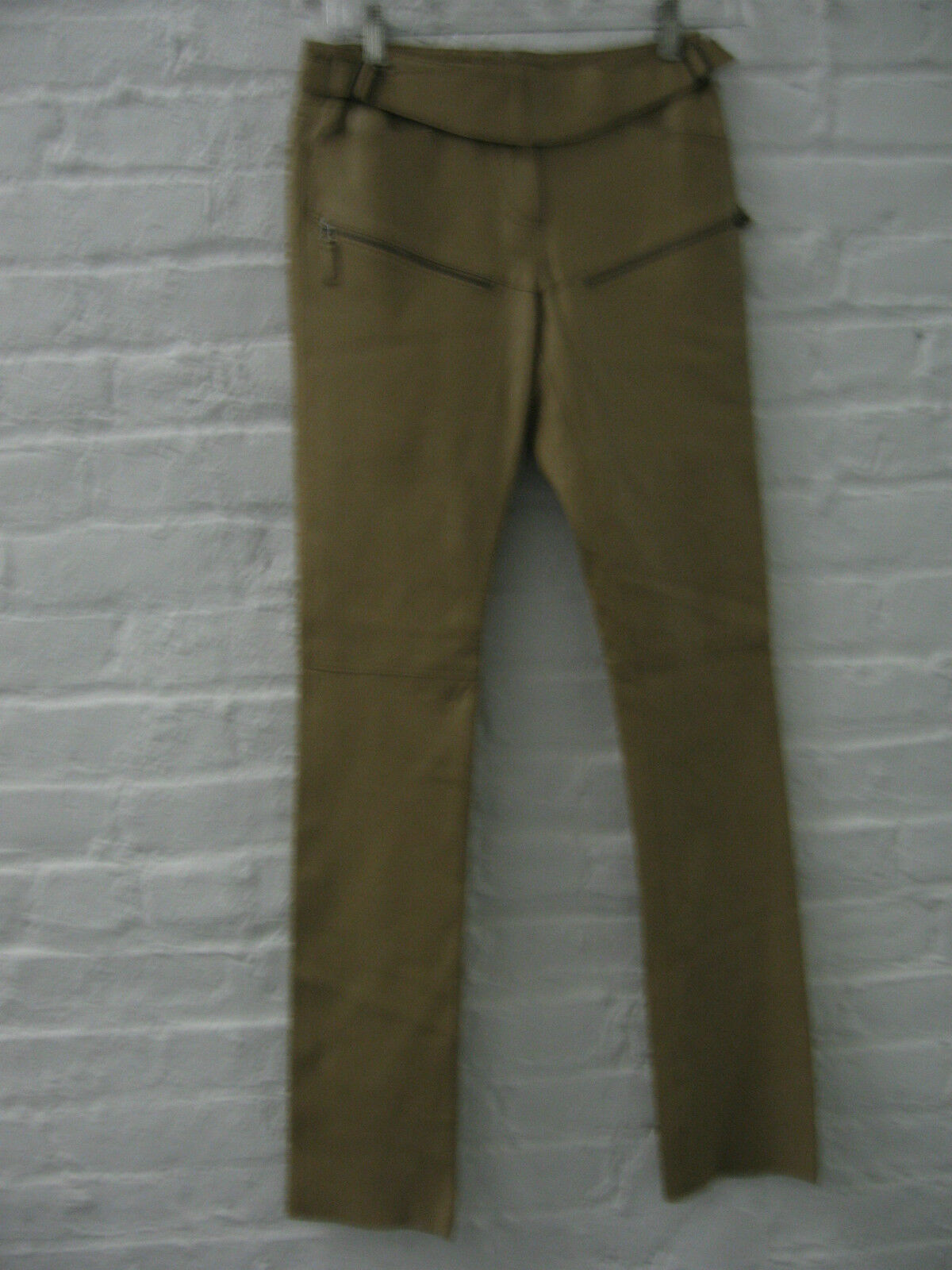 Tight fitting camel leather pants by Max Studio. New with tags.