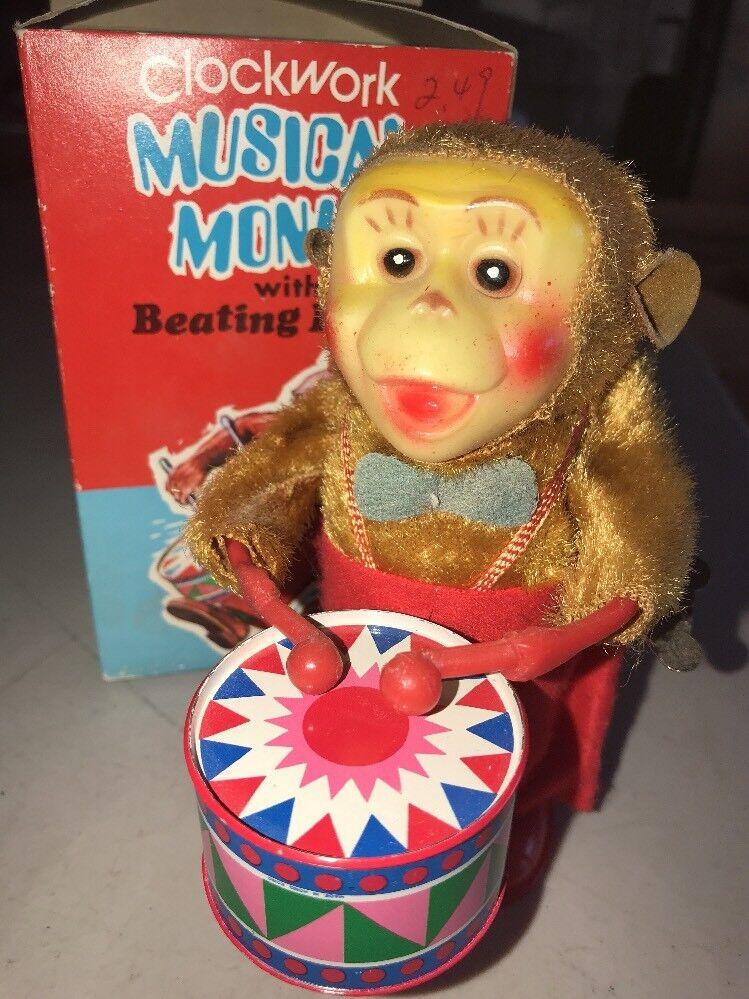 Vintage clockwork MONKEY W paliza Tambor Musical Con Caja De Hojalata Funciona