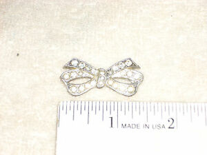 1 1/2 inch Silvertone Stone Studded Ribbon Bow Goody Pat Pend Brooch