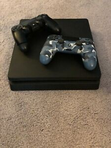 Pre-owned PS4 Slim with 2 controllers - good condition